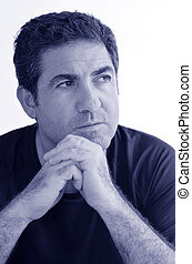 Mature man thinking with hands on chin looking away.close up...