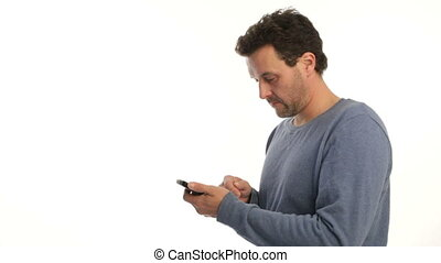 Mature man typing text smart phone