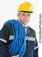 Mature man wearing hardhat with cable
