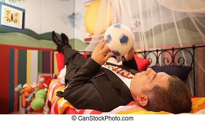 Mature man wearing suit playing wit