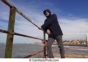 Mature man windy sunny day