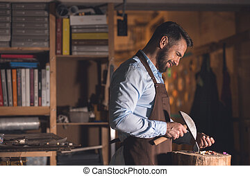 Mature man with a mosaic at work