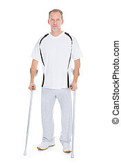 Mature Man With Crutches