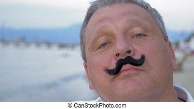 Mature Man with Funny False Moustache - Closeup shot of...
