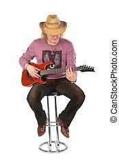 Mature man with guitar. Full body.