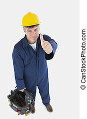 Mature man with tool bag showing thumbs up sign - High angle...