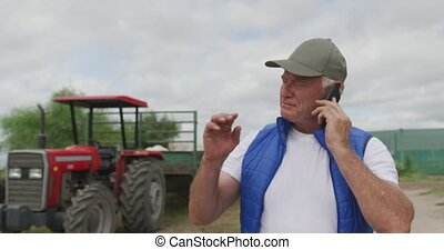 Mature man working on farm - Front view of a mature ...
