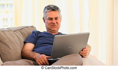 Mature man working on his laptop