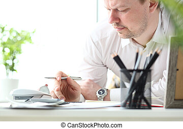 Mature man working with calculator evaluating financial opportunities for family vacation