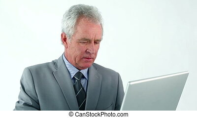 Mature manager using a laptop