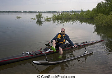 mature paddler in racing outrigger canoe