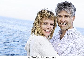 Mature romantic couple at seashore - Portrait of mature ...