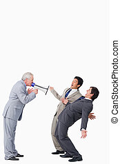 Mature salesman with megaphone yelling at his employees