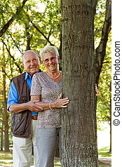 mature senior couple is in love. man handed a rose.