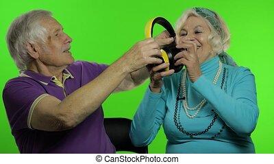 Mature senior old couple family grandparents enjoy talking, ...