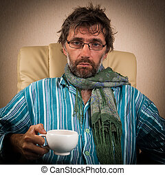 sick man sitting in chair with cup