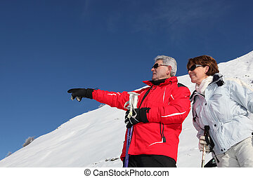 Mature ski couple on a mountain