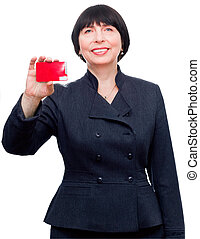 Mature smiling business woman holding a credit card -...