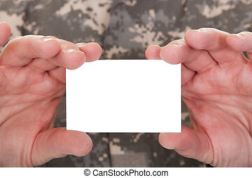 Mature Soldier Holding Blank Paper