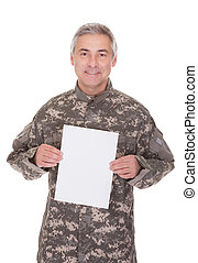 Mature Soldier Holding Blank Paper Isolated On White...
