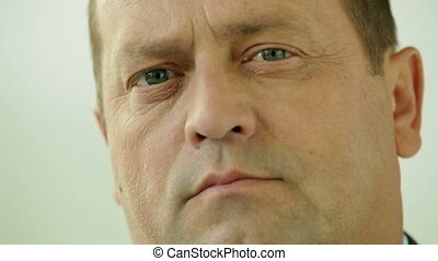 Mature stare - Close-up of a mature man staring at the...