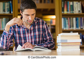 Mature student studying at desk in
