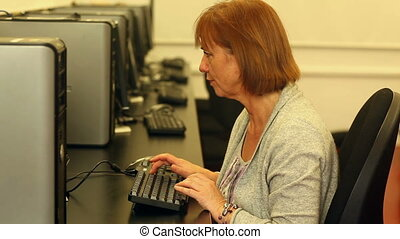 Mature student working with a computer