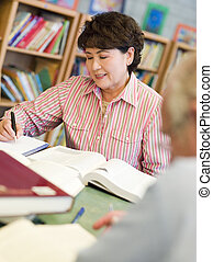 Mature students studying in library