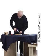 Mature tailor at work
