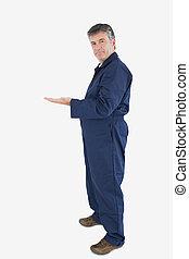 Mature technician gesturing - Portrait of mature technician...