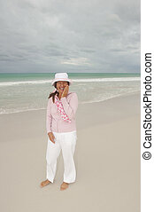 Mature woman active retirement beach isolated