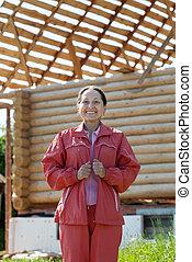 mature woman against building home