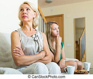 Mature woman and  adult daughter having quarrel