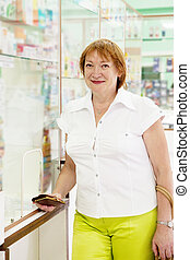 Mature woman at pharmacy