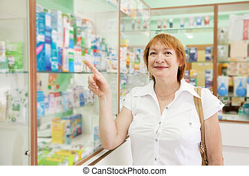 Mature woman at the pharmacy