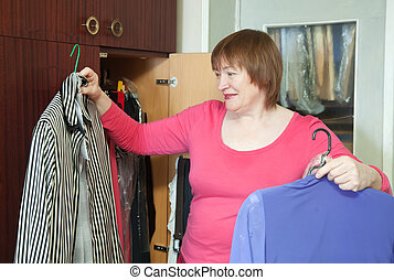 Mature woman at wardrobe
