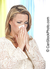 Mature woman blows her nose