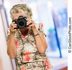 Mature Woman Capturing Photo