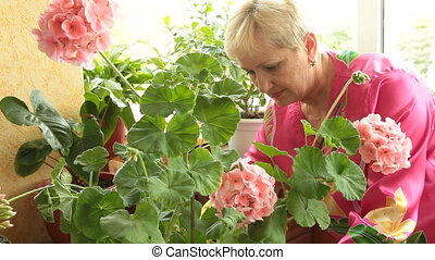 Mature woman caring for flowers
