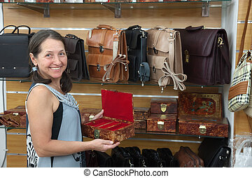 woman chooses leather chest