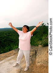 Mature woman cliff - Mature woman standing on a cliff...