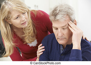 Mature Woman Comforting Man With Depression