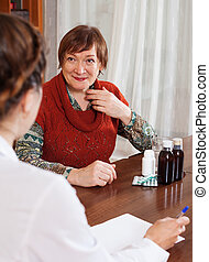 mature woman complaining to doctor about feels