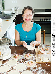 Mature woman cooking dumplings