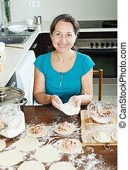 Mature woman cooking dumplings