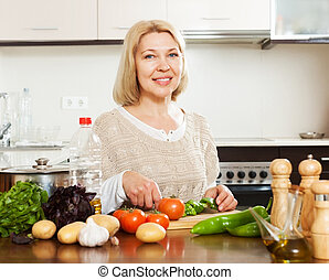 woman cooking vegetables at home