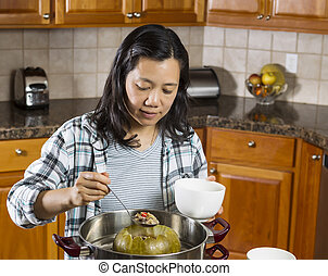 Mature Woman Cooking Winter Melon at home