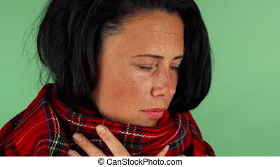 Mature woman coughing feeling sick and tired