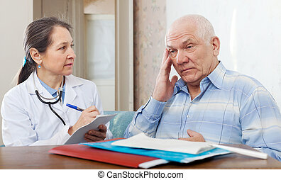 doctor examining the senior patient