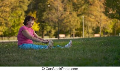Mature woman doing exercises